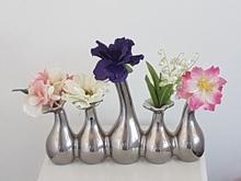 Vaasjes inclusief bloemen